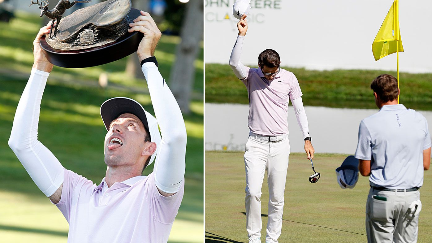 Dylan Frittelli holds the trophy after winning the John Deere Classic