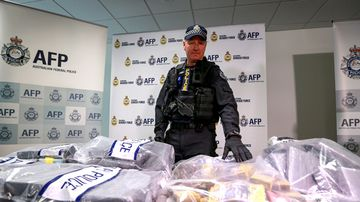 An Australian Federal Police officer at a 2017 press conference about an investigation which has resulted in the arrests of seven men, and the seizure of a significant quantity of cocaine and cash in Melbourne, Australia.