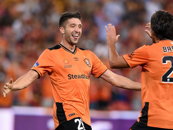 Brandon Borrello celebrates a goal with Thomas Broich. (AAP)
