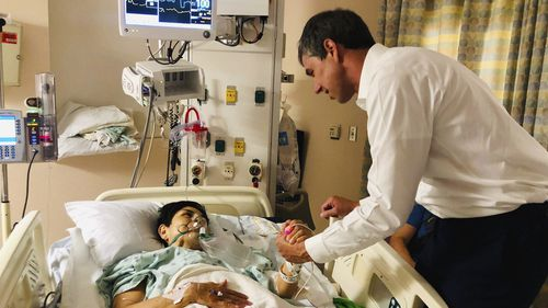 Presidential candidate Beto O'Rourke visits a survivor of the El Paso massacre.