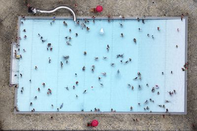 Visitors taking a dip in a public pool are photographed from a small plane in Kleinmachnow, eastern Germany.