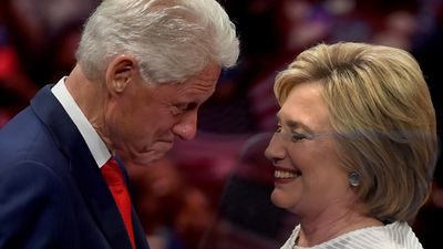 Ms Clinton and her husband, former US president Bill Clinton, share a moment on stage during her primary night event in New York on June 7.