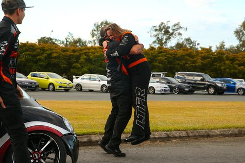 Kelly hugs her team owner Phil Lamattina after leaping from the cabin. Picture: Drag Photos