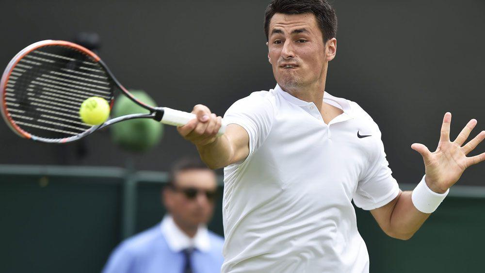 Bernard Tomic scrapes through at Wimbledon