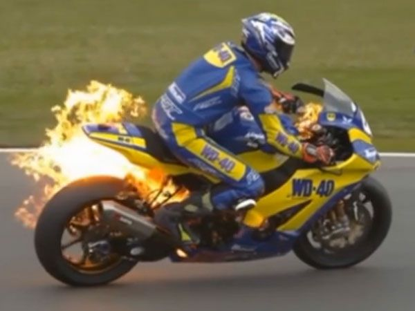 Racer's lucky escape after Superbike bursts into flames