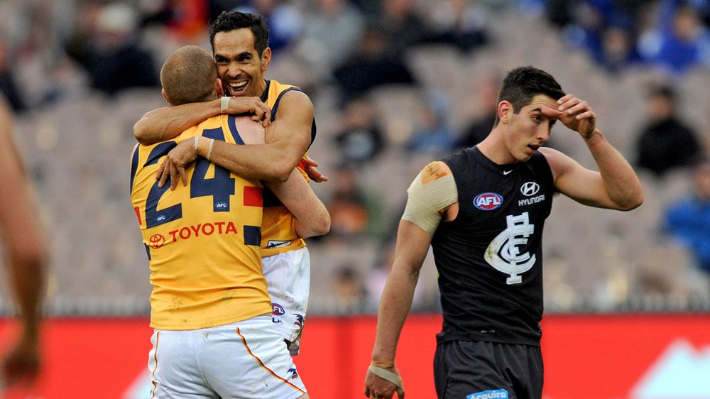 Crows fly high to bury AFL Blues
