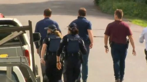 Dozens of officers swarmed the streets of Taringa today. (9NEWS)