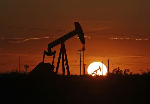 A pump jack operates in an oil field in the Permian Basin in Texas.