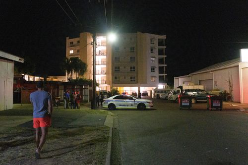 Police cordon off Palms Motel after the shooting (AAP Image/Michael Franchi).