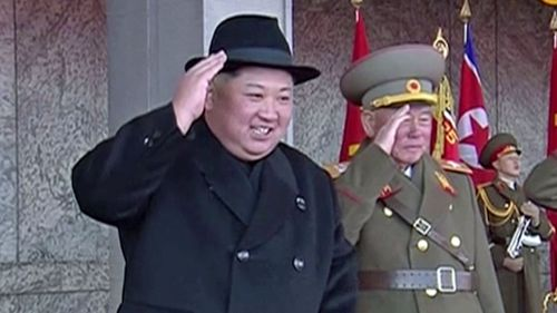 Kim Jong Un salutes the parade with his leading generals. (AP).
