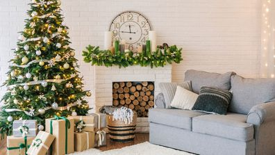 Christmas decorations and a garland on the tree in a living room