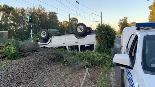 High-range 'drink driver' rolls 4WD onto train tracks at Lake Macquarie