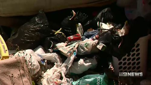 Piles of rubbish were allegedly discovered in the house.