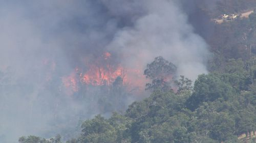 A major bushfire is threatening homes in Perth's north-east.