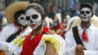 Dressing up as skulls or skeletons is part of the fun