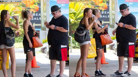 Pic exclusive! Fuller-figured Kyle Sandilands in Fiji with girlfriend ... staying at $8220 a night resort