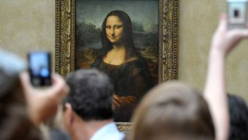 Visitors take pictures of Leonardo da Vinci's Mona Lisa, at the Louvre Museum in Paris