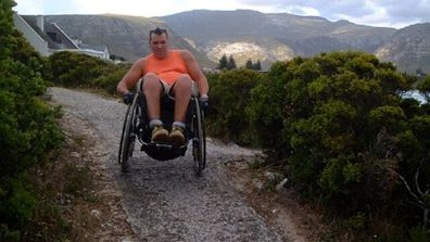 Chris in a wheelchair hiking