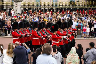 Spectators attend the first Changing the Guard outside Buckingham Palace, since the beginning of the Covid19 pandemic, in London.