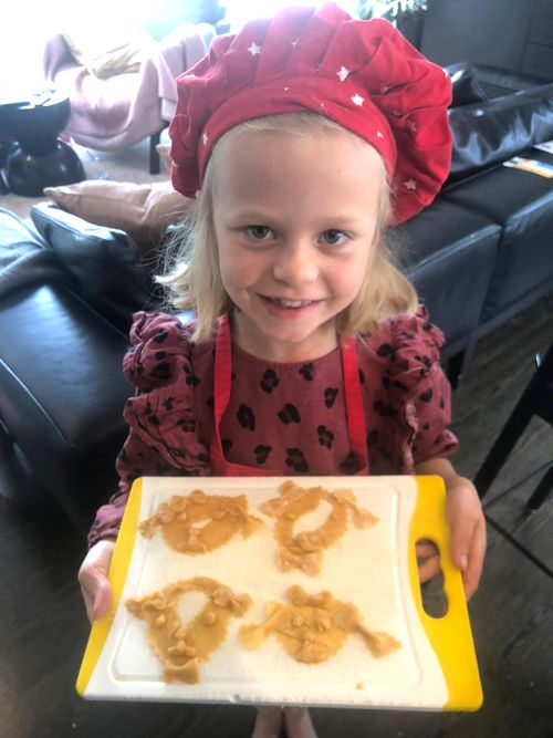 Sienna Guise, now 8, holds a tray of pasta she made during the first lockdown in New Zealand.