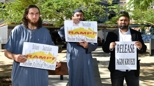Supporters of Agim Kruezi are seen outside the Brisbane Supreme Court. Picture: AAP