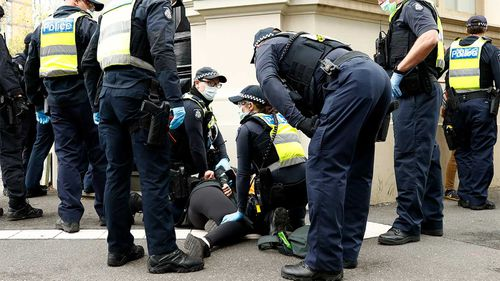 A protester is arrested in Melbourne.