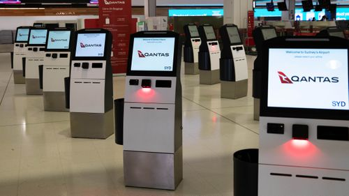 An empty Qantas check in area at Sydney International Airport.