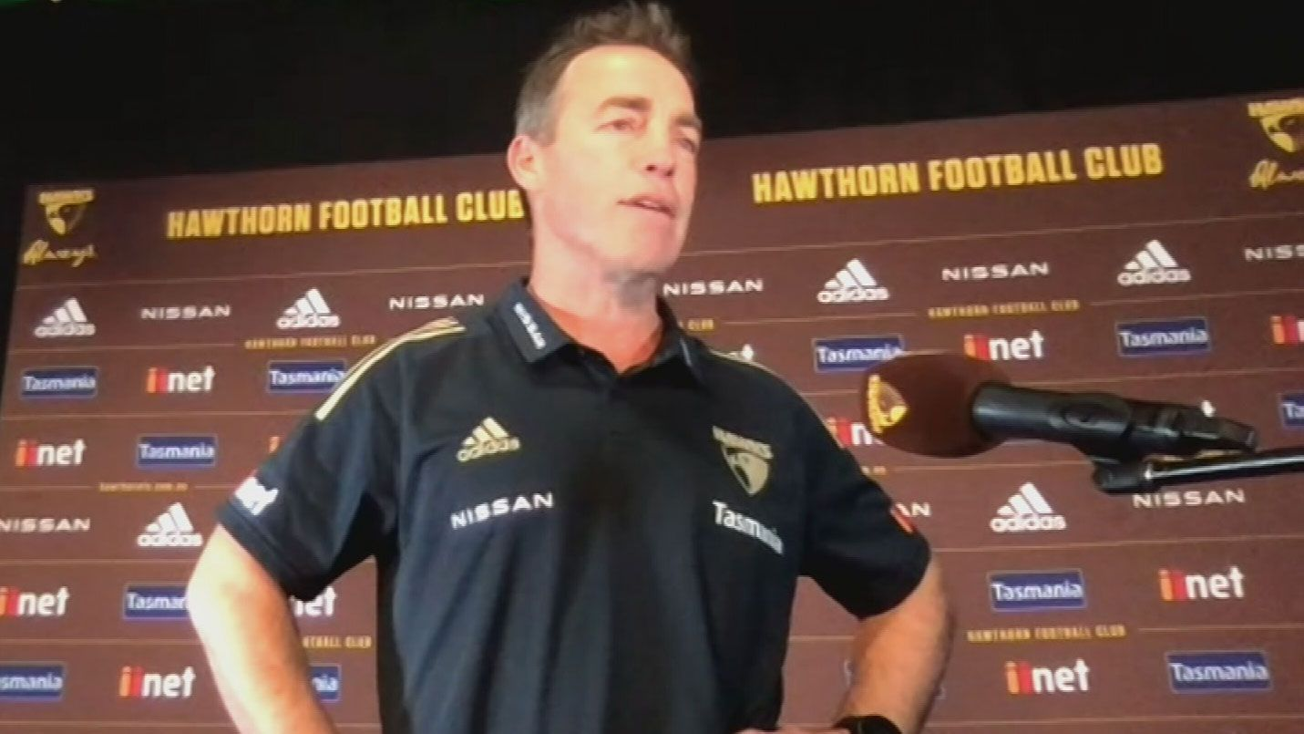 Hawks coach Alastair Clarkson addresses the media.