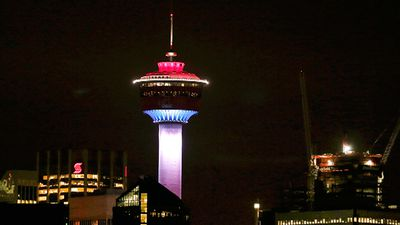 The Calgary Tower in Alberta, Canada, is lit with the colours of the French flag in a show of support for the victims of the Paris attacks.
