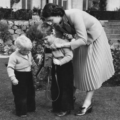 1952: Queen Elizabeth II helps her son Prince Charles to take a picture of his sister, Princess Anne, Balmoral.