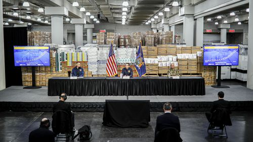 Gov. Andrew Cuomo speaks while practicing social distancing against a backdrop of medical supplies during a news conference at the Jacob Javits Center that will house a temporary hospital in response to the COVID-19 outbreak.