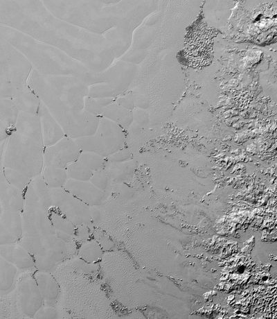 Nitrogen ice glaciers on Pluto, photographed during the New Horizons mission.<br /><br />Each hills spans several kilometres, and the group has been informally named Sputnik Planum.(NASA/JHUAPL/SwRI)
