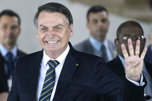 Brazil's President Jair Bolsonaro gestures as he welcomes leaders of the BRICS emerging economies at the Itamaraty Palace in Brasilia, Brazil, in 2019