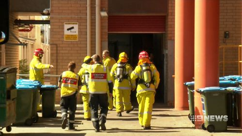 Eight fire crews entered the hospital wearing protective gear. (9NEWS)