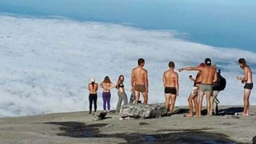 Malaysian authorities took action against these western tourists after they stripped on top of a sacred mountain in 2015.