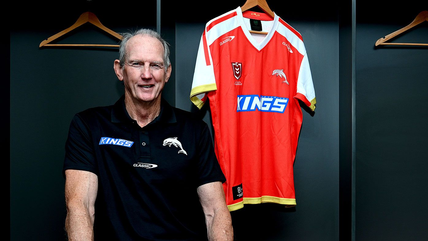 Wayne Bennett poses for a photo with the revealing of the Dolphins Heritage Round jersey