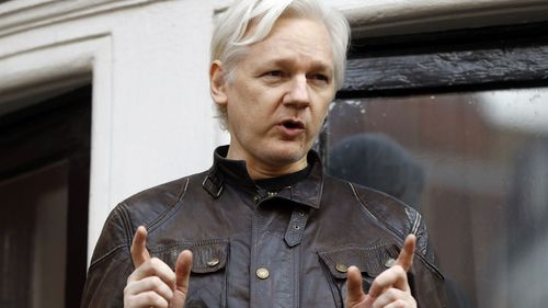 In this May 19, 2017, file photo, WikiLeaks founder Julian Assange gestures to supporters outside the Ecuadorian embassy in London, where he has been in self imposed exile since 2012.