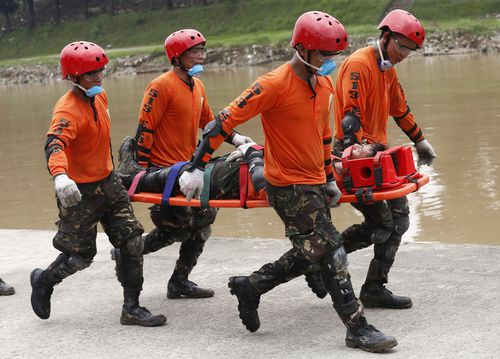 Rescue crews practice drills ahead of the typhoon which is set to make landfall tomorrow.