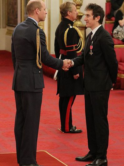 Prince Harry presenting Geraint Thomas with his OBE