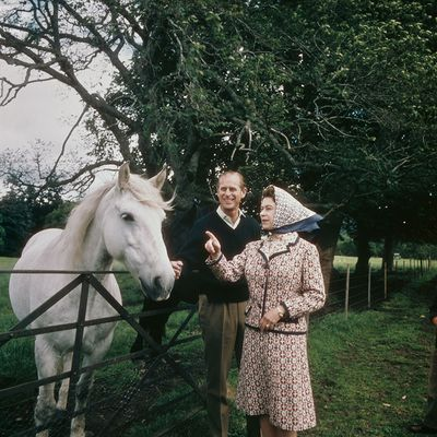 1972: Queen Elizabeth II and Prince Philip visit a farm on the Balmoral estate in Scotland, during their Silver Wedding anniversary year.