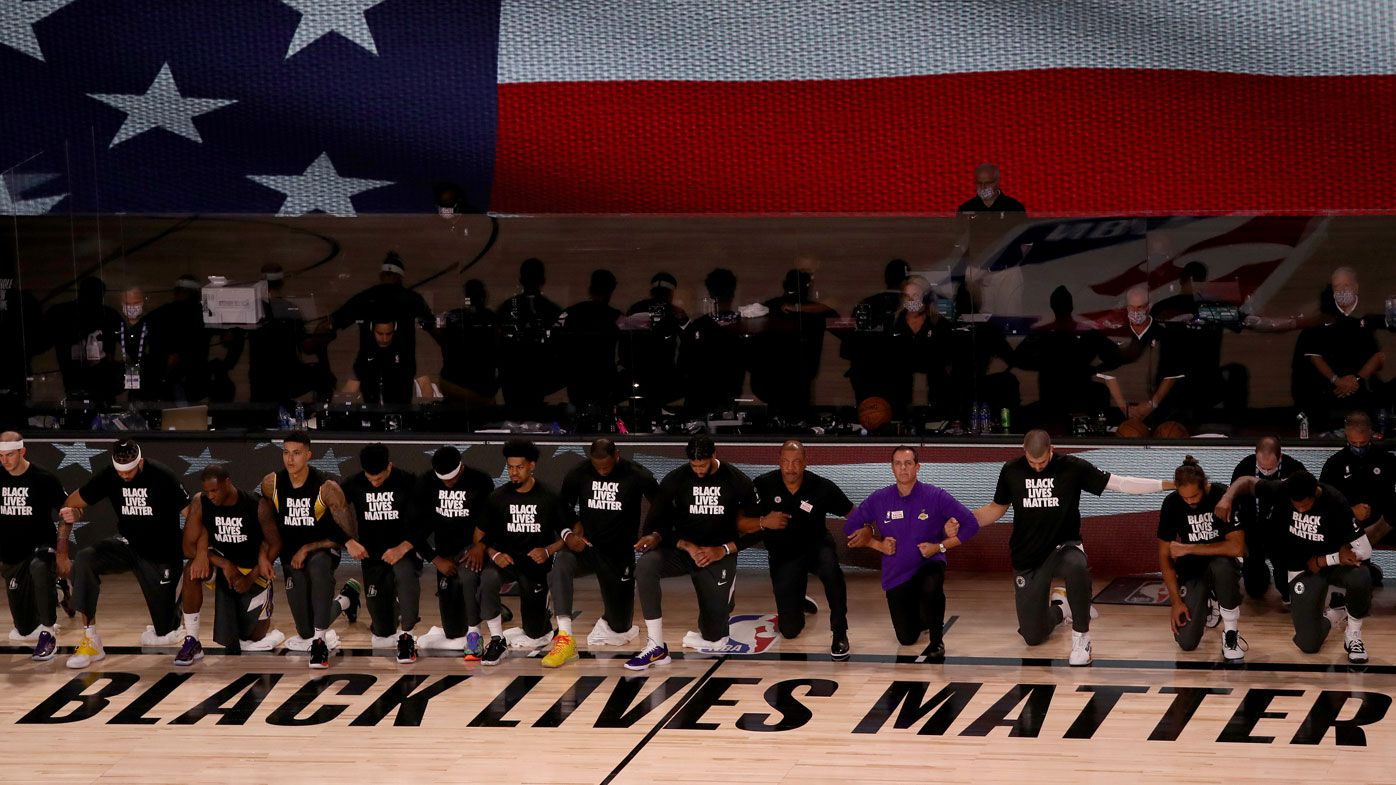 Players kneel in solidarity for the Black Lives Matter movement ahead of the NBA season restart. (Getty)