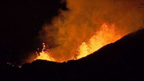 Lava fountaining at a fissure from the volcano, near Pahoa on the island of Hawaii