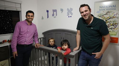 Andrew and Elad Dvash-Banks with Ethan and Aiden. Photo: AP