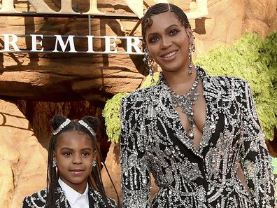 """Beyonce, right, and her daughter Blue Ivy Carter arrive at the world premiere of """"The Lion King"""" in Los Angeles on July 9, 2019."""