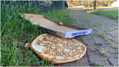 A man has been charged after allegedly using his own phone to call a pizza delivery man and rob him in Adselaide's north.