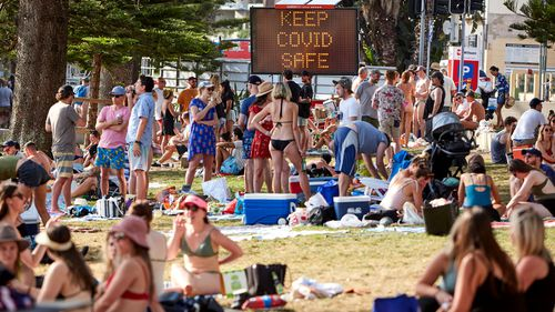 People in Sydney gather at a beach in Manly, on the city's north shore.