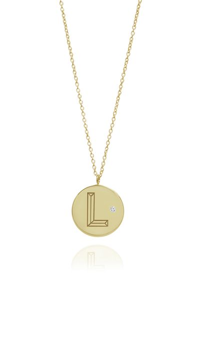 "<p><a href=""https://www.notjustalabel.com/shop/myiabonner/gold-diamond-initial-necklace"" target=""_blank"">Gold With Diamond Initial Necklace, approx. $457, Myia Bonner</a></p>"