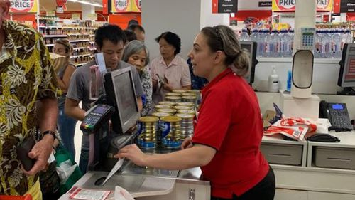 Shoppers would allegedly buy two cans, exit the store and then return to buy more.