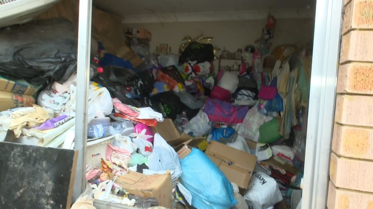 Hoarder trapped for 14 hours after rubbish in house falls on her