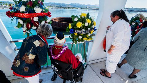 John Mathrusse, centre, gazes out from the Arizona Memorial. (AAP)